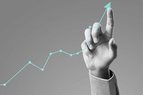 Fundo Exclusivo - Um dedo desenhando um gráfico de investimento