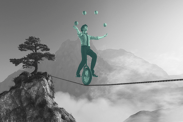 Índices de mercado - uma pessoa num monociclo em cima da corda equilibrando bolas