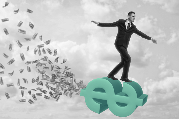 viver de renda: uma pessoa surfando numa cifra de dinheiro