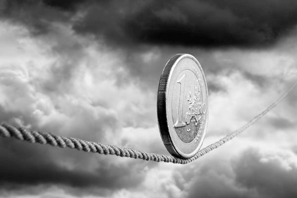 Risco e Retorno - Moeda de 1 euro sobre uma corda bamba
